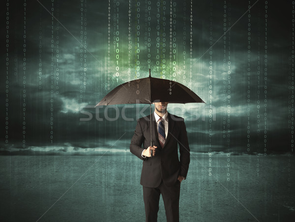 Stock photo: Business man standing with umbrella data protection concept