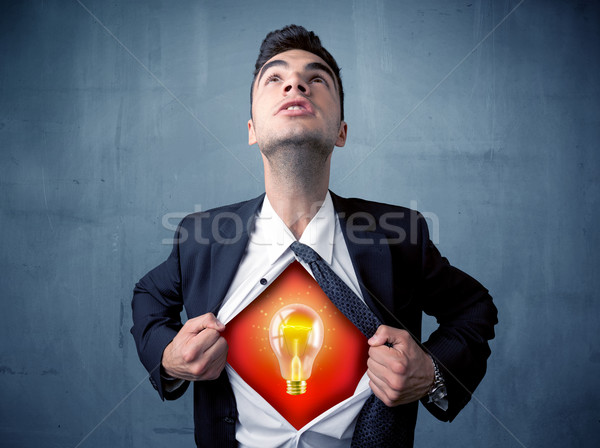 Businessman ripping off shirt and idea light bulb appears  Stock photo © ra2studio