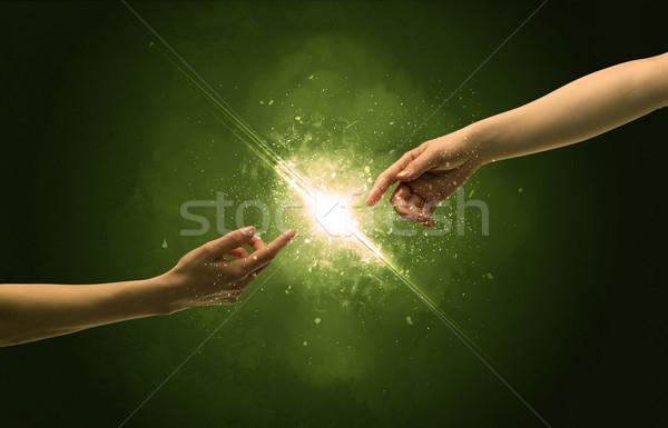 Toucher bras éclairage susciter bout des doigts deux Photo stock © ra2studio