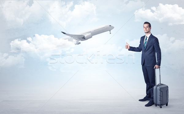 Agent hitchhiking with departing plane concept Stock photo © ra2studio