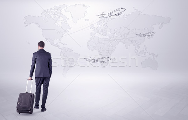 Businessman planning his trip over the world Stock photo © ra2studio