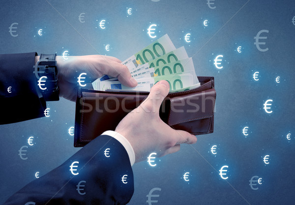 Argent portefeuille main sur euros symbole Photo stock © ra2studio