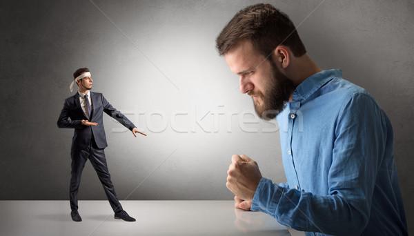 Giant man yelling at a small karate man Stock photo © ra2studio