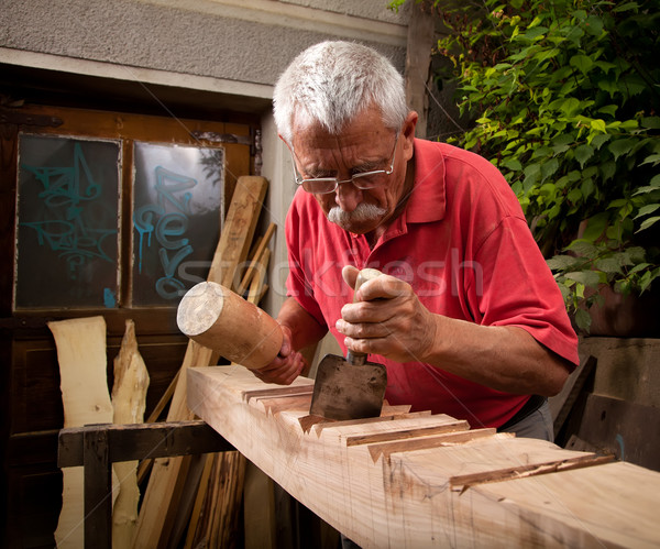 woodcarver working with mallet and chisel 5 Stock photo © ra2studio