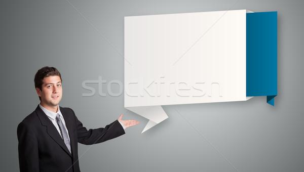 Vonzó férfi bemutat modern origami copy space Stock fotó © ra2studio