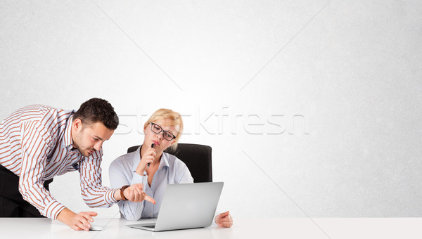 Businessman and businesswoman with plain white copy space Stock photo © ra2studio