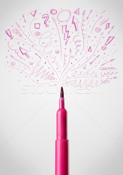 Felt pen close-up with sketchy arrows Stock photo © ra2studio