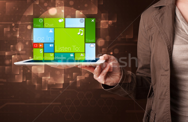 Lady holding tablet with modern software operational system Stock photo © ra2studio