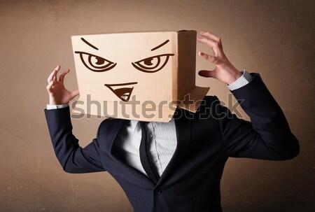 üzletember gesztikulál kartondoboz fej gonosz áll Stock fotó © ra2studio
