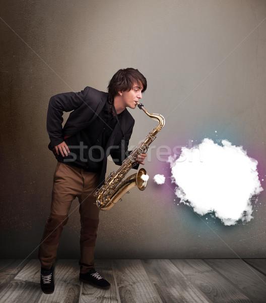 Fiatalember játszik szaxofon copy space fehér felhő Stock fotó © ra2studio