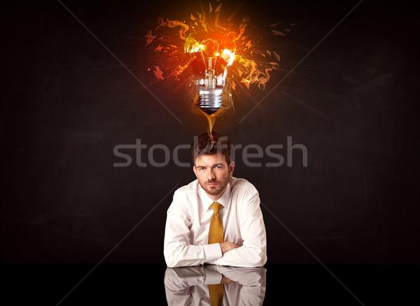 üzletember ül fúj ötlet villanykörte lehangolt Stock fotó © ra2studio