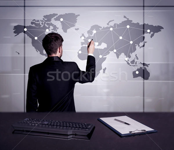 Business person drawing dots on world map Stock photo © ra2studio