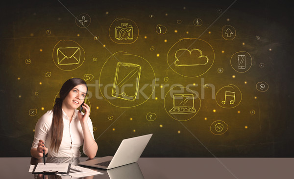 businesswoman with all kind of hand-drawn media icons Stock photo © ra2studio