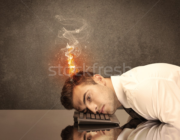 Sad business person's head catching fire Stock photo © ra2studio