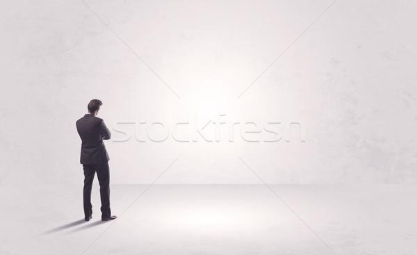 Pénzügy munkás áll merő semmi elegáns Stock fotó © ra2studio