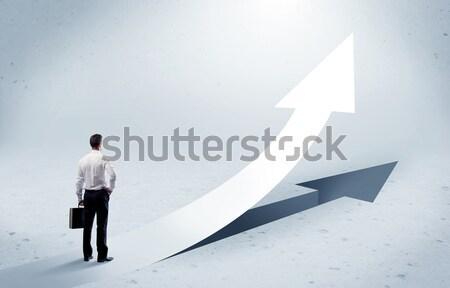 Arrow pointing up with standing salesman Stock photo © ra2studio