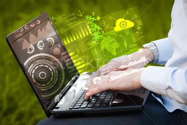 Modern notebook computer with future technology symbols Stock photo © ra2studio