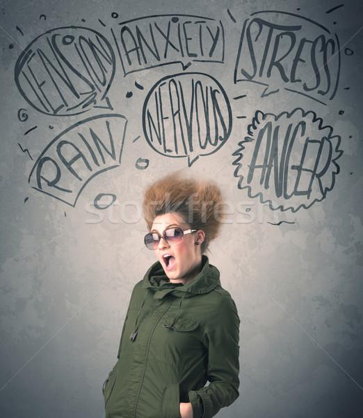 Mad jonge vrouw extreme vrouw gezicht Stockfoto © ra2studio