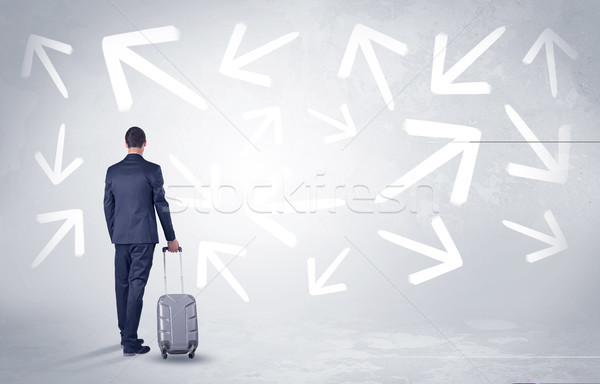 Businessman leaving with pell-mell arrows around Stock photo © ra2studio
