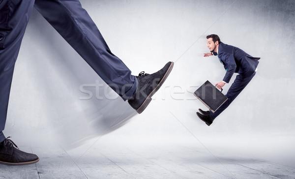 Big leg kicking small man Stock photo © ra2studio