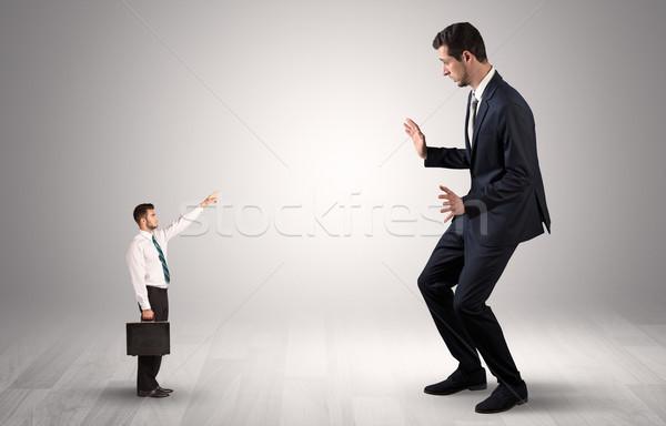 Kicsi üzletember mutat óriás póló félő Stock fotó © ra2studio