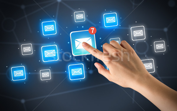 Hand touching mail icon Stock photo © ra2studio