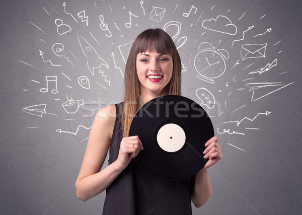 Lady holding vinyl record Stock photo © ra2studio