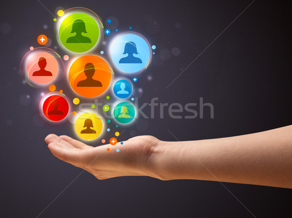 Social network icons in the hand of a woman Stock photo © ra2studio