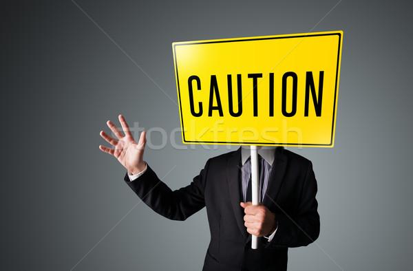 Zakenman voorzichtigheid teken permanente Geel Stockfoto © ra2studio