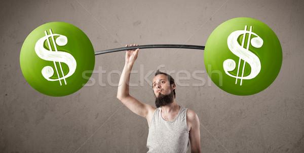 Sovány fickó emel zöld dollárjel súlyok Stock fotó © ra2studio