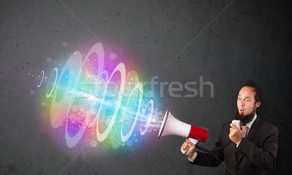 Férfi hangfal színes energia nyaláb ki Stock fotó © ra2studio