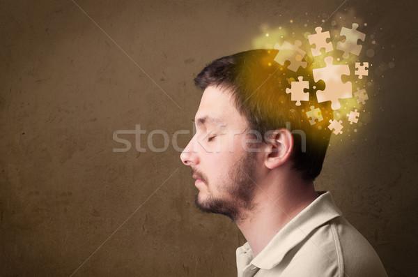 Genç kişi düşünme bilmece akla Stok fotoğraf © ra2studio