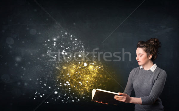 Young lady reading a magical book Stock photo © ra2studio