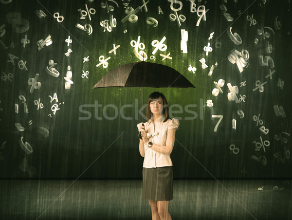 Businesswoman standing with umbrella and 3d numbers raining conc Stock photo © ra2studio