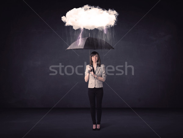 Businesswoman standing with umbrella and little storm cloud Stock photo © ra2studio