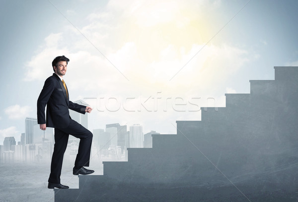 Businessman climbing up a concrete staircase concept Stock photo © ra2studio