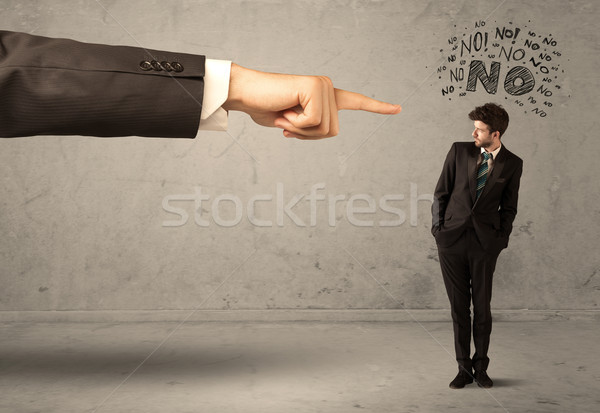 Boss hand guiding beginner salesman Stock photo © ra2studio