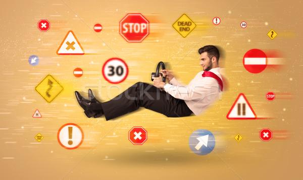 Młodych kierowcy znaki drogowe około drogowego tle Zdjęcia stock © ra2studio