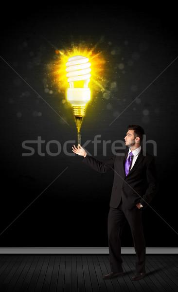 Businessman with an eco-friendly bulb Stock photo © ra2studio