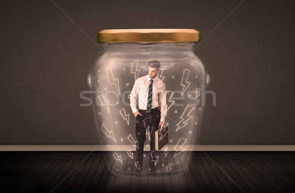 Stock photo: Businessman inside a glass jar with lightning drawings concept