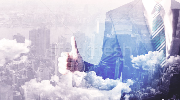 Business man standing at city view background Stock photo © ra2studio