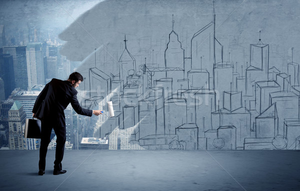 Elegant salesman repainting the city on wall Stock photo © ra2studio