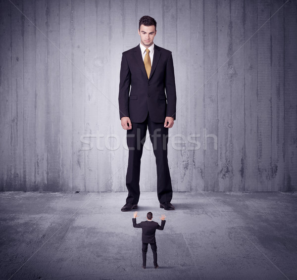 Huge boss lokking at small business man Stock photo © ra2studio