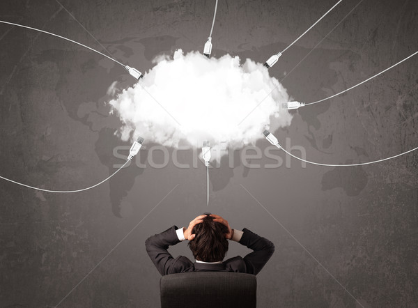 Young man looking at cloud transfer world service  Stock photo © ra2studio
