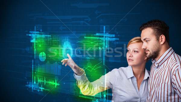 Young business couple pressing modern technology panel with fing Stock photo © ra2studio