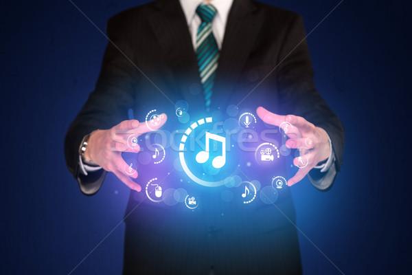 Człowiek cyfrowe multimedialnych ikona biznesmen Zdjęcia stock © ra2studio