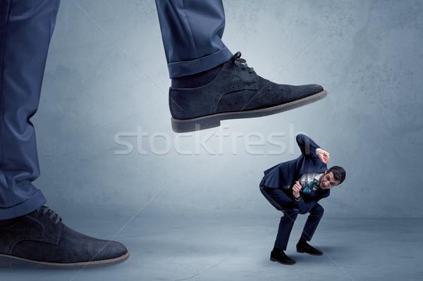 Kicsi üzletember öltöny fiatal nagy láb Stock fotó © ra2studio