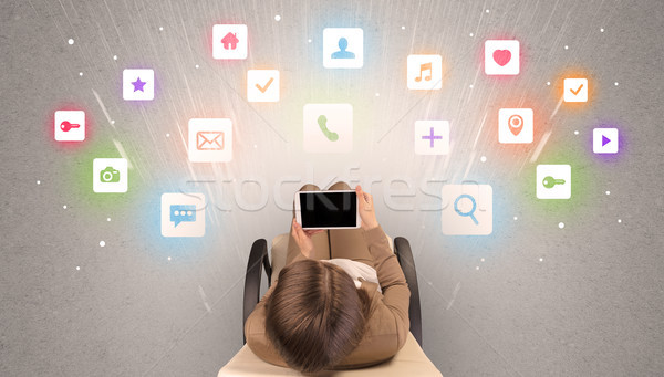 Application icons with woman using tablet Stock photo © ra2studio