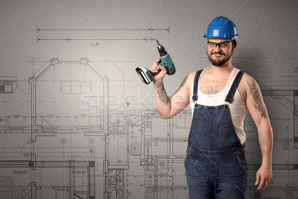 Stock photo: Worker with technical drawing.