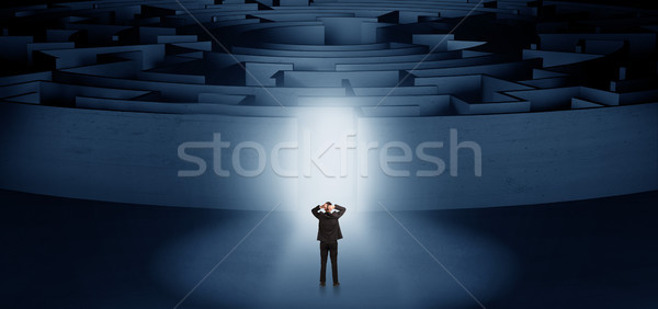 Businessman starting a concentric labyrinth Stock photo © ra2studio